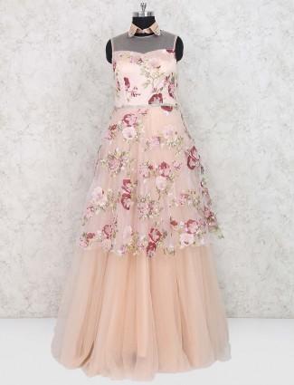 Wedding wear peach hued printed gown