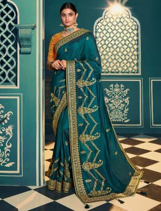 Wedding wear raw silk green saree