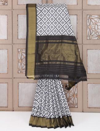 White and black color silk patola saree