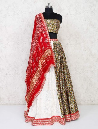 White and green half-half semi stitched lehenga in georgette and patola silk
