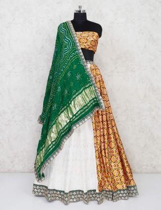 White and yellow half-half semi stitched lehenga in georgette and patola silk