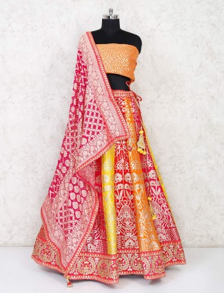 Yellow and orange semi stitched lehenga choli in silk