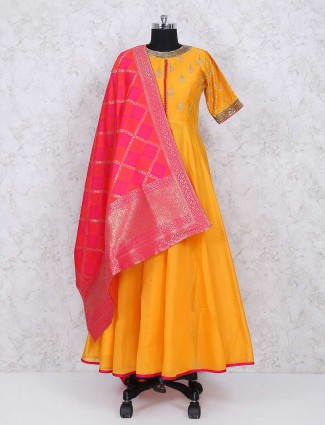 Yellow color floor length anarkali suit in cotton silk fabric