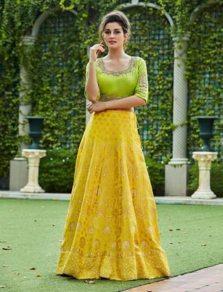 Yellow color lehenga choli in raw silk