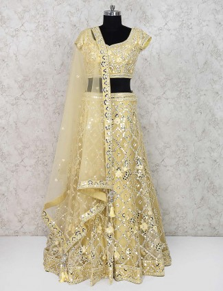 Yellow color net wedding lehenga choli