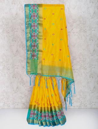 Yellow color saree in semi silk fabric