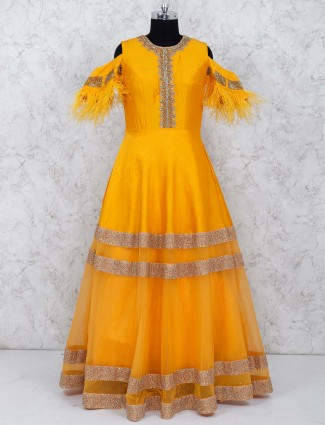 Yellow color silk and net fabric gown
