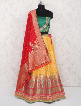 Yellow colored banarasi silk semi stitched lehenga choli