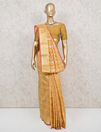 Yellow colored cotton banarasi silk saree
