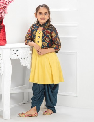 Yellow colored punjabi jecket style dhoti suit