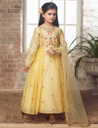 Yellow colored raw silk anarkali suit for wedding