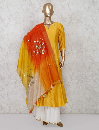 Yellow colored sharara suit in silk fabric