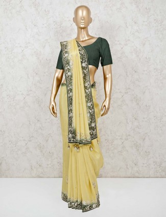 Yellow embroidered wedding muga silk saree