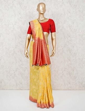 Yellow festive wear in muga silk saree