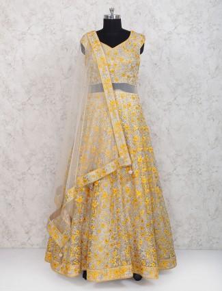Yellow hue net fabric floor length anarkali suit