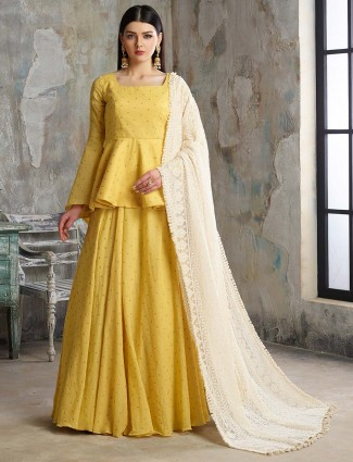Yellow hue peplum style lehenga cum salwar suit