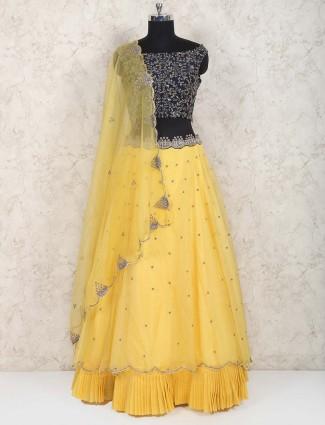 Yellow hue tissue silk frill style lehenga choli