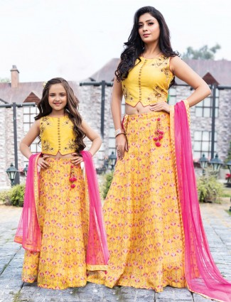 Yellow lehenga choli for mother and daughter in raw silk