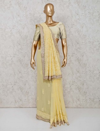 Yellow lucknowi georgette saree for party