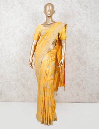 Yellow muga silk saree with gold zari weaving