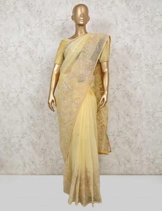 Yellow organza tissue saree for wedding reception