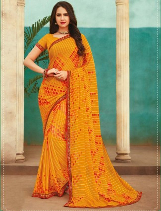 Yellow printed georgette saree for festival occasion
