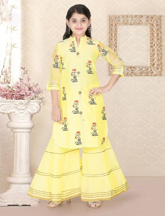 Yellow printed punjabi sharara suit in cotton silk