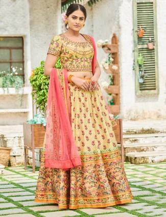 Yellow printed semi stitched silk wedding lehenga choli