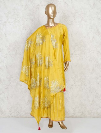Yellow zari thread work palazzo suit in cotton silk